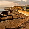 Groynes and huts and cliffs
