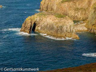 Rock in a sapphire sea