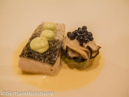 Steamed cornish bass, poached oyster, pickled cucumber, squid ink, champagne sauce