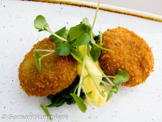 Brixham crab cakes, wilted kale