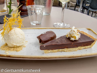 Salted chocolate tart, caramel popcorn, vanilla ice cream