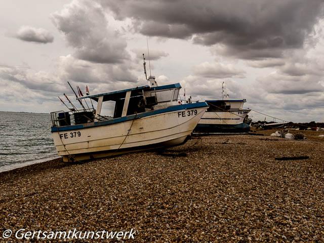 Fishing boats  dark clouds