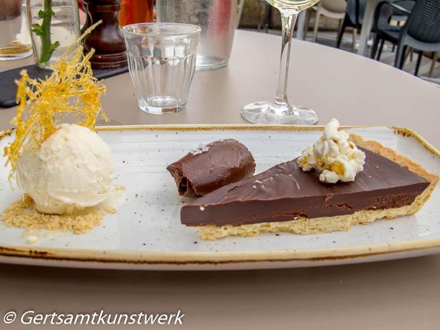 Salted chocolate tart, caramel popcorn, vanilla ice cream
